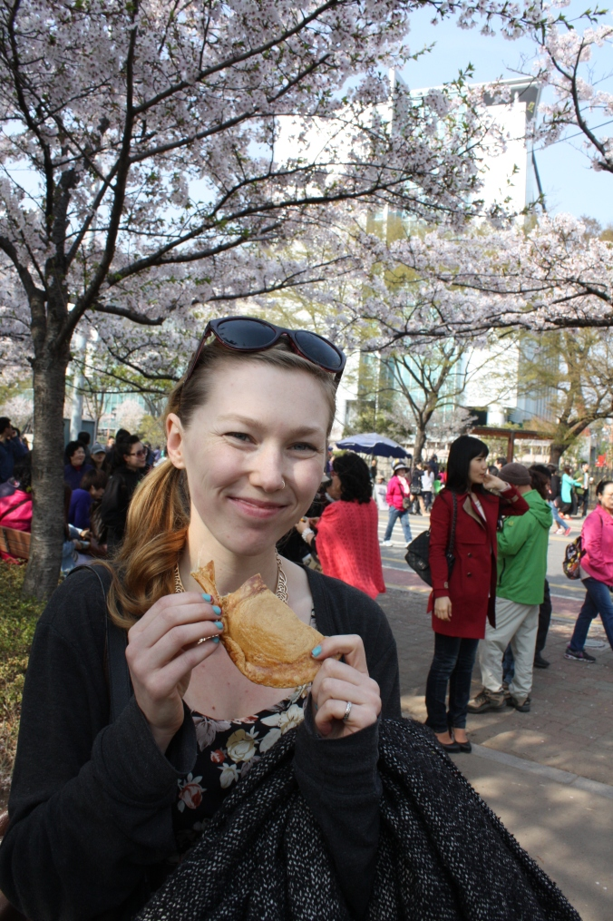 Me eating 뽑기. I would smile larger, but my teeth were stuck together with tasty sugar ^^