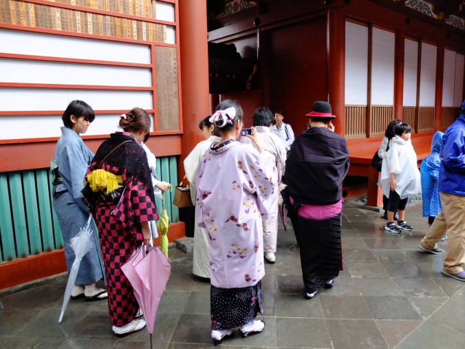 Some girls in pretty summer yukata.  One had a punky bright pink-black yukata with fedora. So cute!